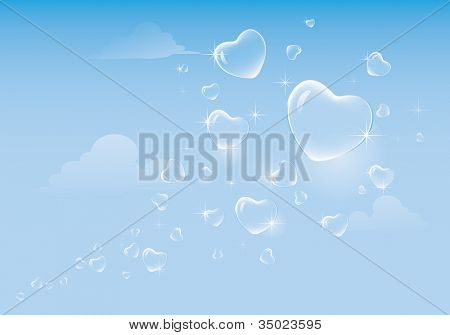 Heart shaped bubbles floating on sky.