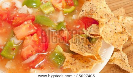 Salsa And Tortilla Chips On A White Plate