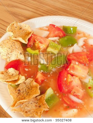 Salsa And Tortilla Chips Sitting On Table