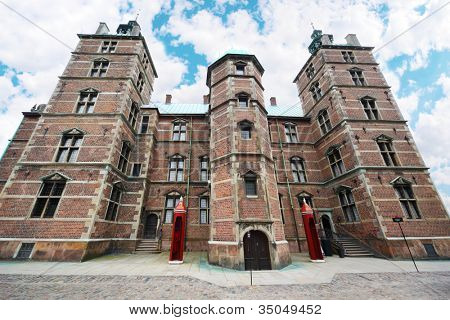 Rosenborg Castle is castle situated at centre of Copenhagen, Denmark. Two red booths for guards.