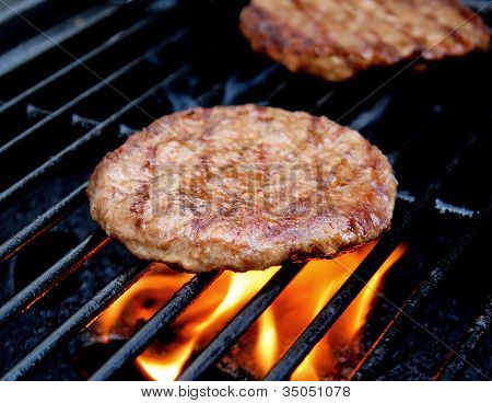 Burgers Cooking On The Grill