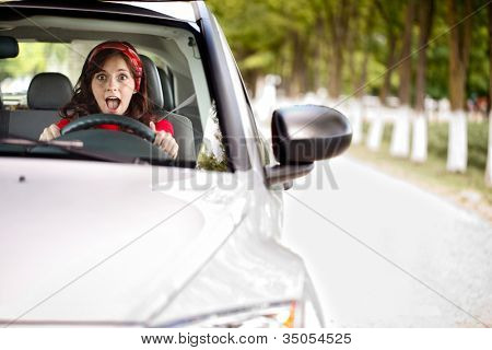 young woman stopping the car and screaming