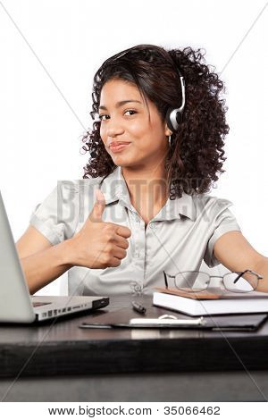 Businesswoman wearing a headset showing thumb up at work isolated on white background.