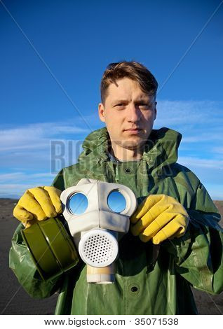 Man In A Overalls With A Gas Mask