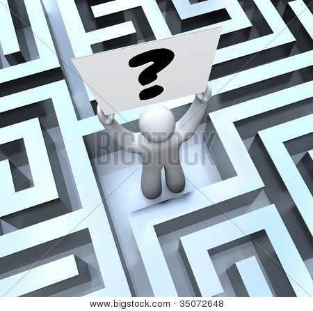 A man lost in a maze or labyrinth holds a question mark sign to seek help in finding a way out or getting an answer or solution to a problem or trouble