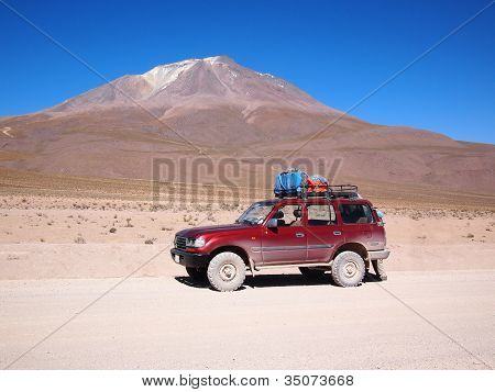 Four-wheel Drive Vehicle In Bolivia Desert