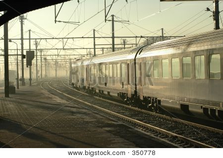 Silver Train In Early Morning Fog