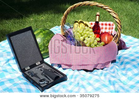 Picnic Basket On A Blue Checkered Cloth Wine And Food