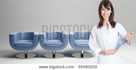 Female healthcare worker and a row of chairs in the background