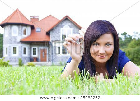 Woman Holding Keys To House