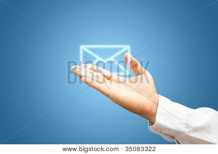 Hand With Mail Symbol On Blue Background