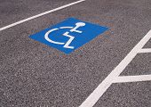 foto of physically handicapped  - painted wheelchair symbol for a handicapped parking spot - JPG