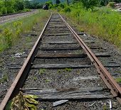 foto of transcontinental  - vintage railroad tracks with vintage locomotive in the background - JPG