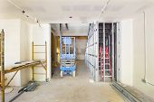 stock photo of stud  - Drywall and Framing with Metal Studs in Commercial Space Construction Site - JPG
