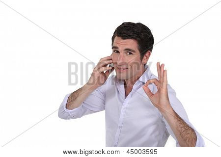 Businessman making OK gesture