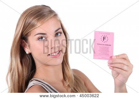 Teenager showing driving licence