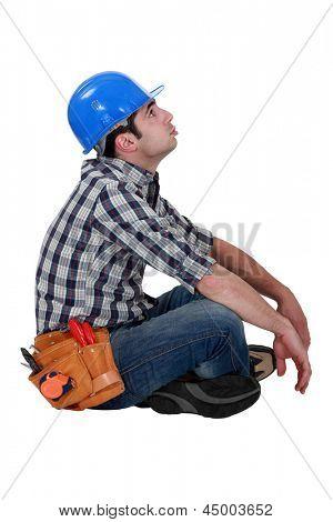 Tired manual worker taking a break