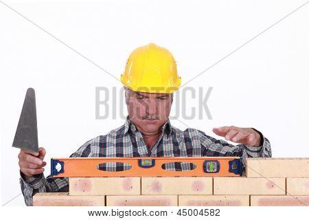Mason leveling brick wall