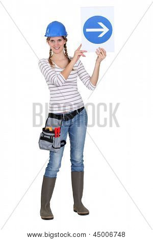 Builder holding traffic sign
