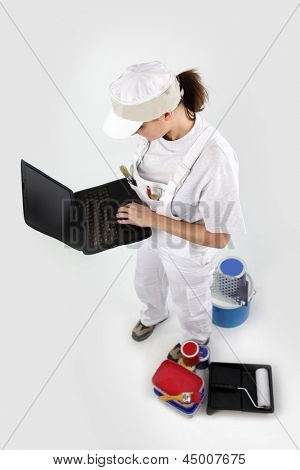 craftswoman painter holding a laptop