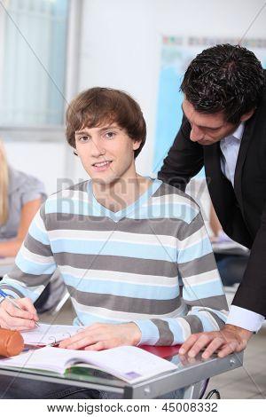 Teacher checking student's work
