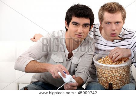 Young men hooked on a video game