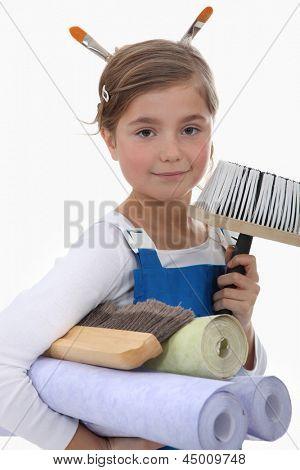 Little girl pretending to be decorator