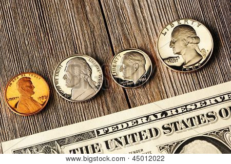 New uncirculated US money over wooden background