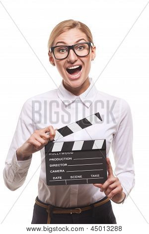 female holding clapper board in her hands