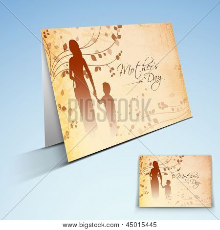 Greeting card or gift card with text Happy Mother's Day and silhouette of a mother holding hand of her child.