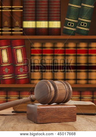 Wooden gavel against a bookcase