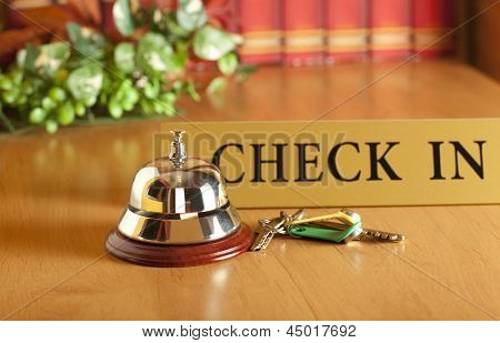 Vintage old hotel bell on the table
