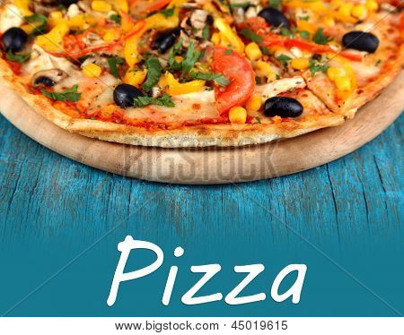 Tasty pizza on blue wooden table close-up