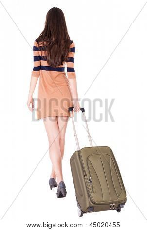 Back view stylishly dressed brunette woman with  suitcase looking up. Standing young girl. Rear view people collection. backside view person. Isolated over white background. l