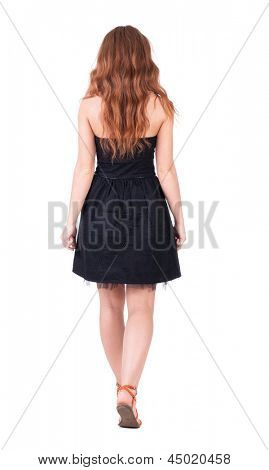 back view of walking young beautiful  redhead woman. girl  watching. Rear view people collection.  backside view person. Isolated over white background. black girl in a summer dress walking distance