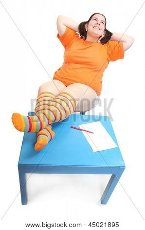 Happy student resting on a school desk.