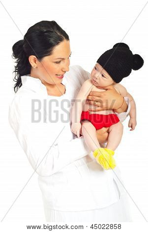 Happy Mother Holding Baby In Mouse Costume