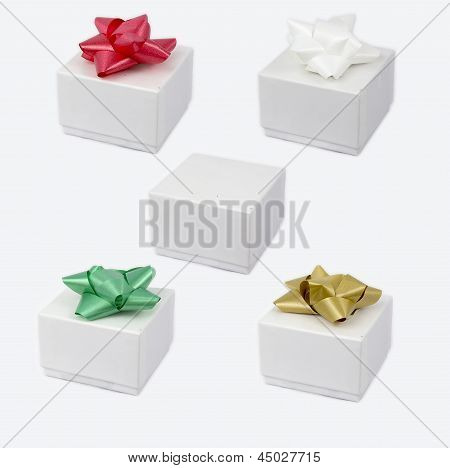 Set Of White Cardboxes With A Bow On Top.