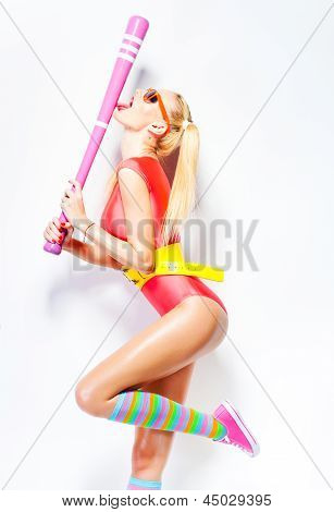Sexy Baseball Girl Wearing Colorfull Clothes Posing With A Baseball Bat