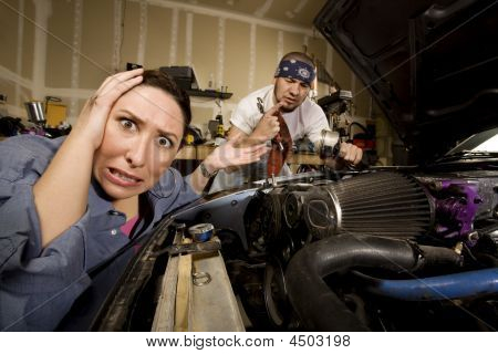 Frustrated Woman With Incompetent Mechanic In Background