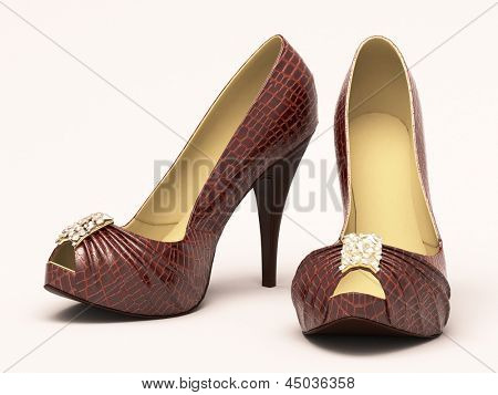 Crocodile leather women's shoes with high heels close up on a light background