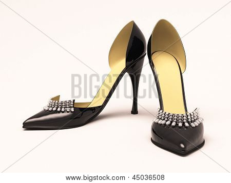 Women's black shoes closeup on a light background