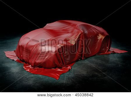 Sports car under cover