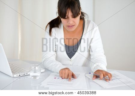 Charming Young Woman Working With Documents