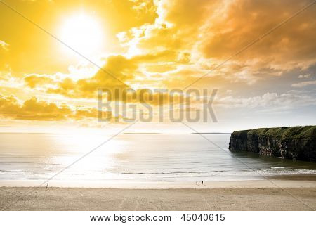 Tourists Walking The Ballybunion Beach And Cliff
