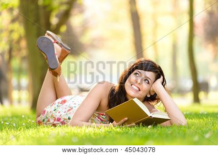 Woman Reading Book And Day Dreaming
