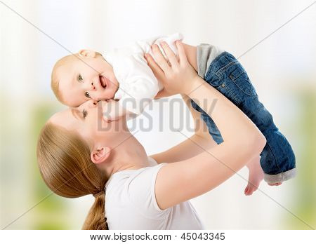 Happy Family. Mother Throws Up Baby, Playing