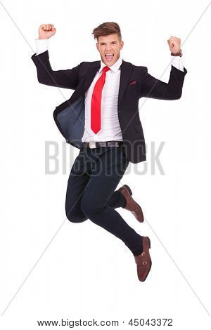 young business man jumping in the air and cheering loud. isolated on white background