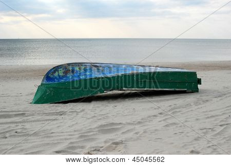 Upturned Boat On The Sand