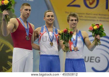 MOSCOW, RUSSIA - APRIL 20: Medalists on pommel horse in 5th European Championships in Artistic Gymnastics in Moscow, Russia on April 20, 2013. Left to right: Berki, HUN, Keatings, Whitlock, both GBR